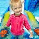 Child on water slide at aquapark. — Stock Photo #9068690