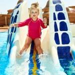 Child on water slide at aquapark. — Stock Photo #9068691