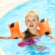 Child with armbands in swimming pool — Stock Photo #9068692