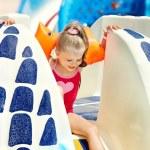 Child on water slide at aquapark. — Stock Photo #9068704