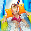 Child on water slide at aquapark. — Stock Photo #9068705