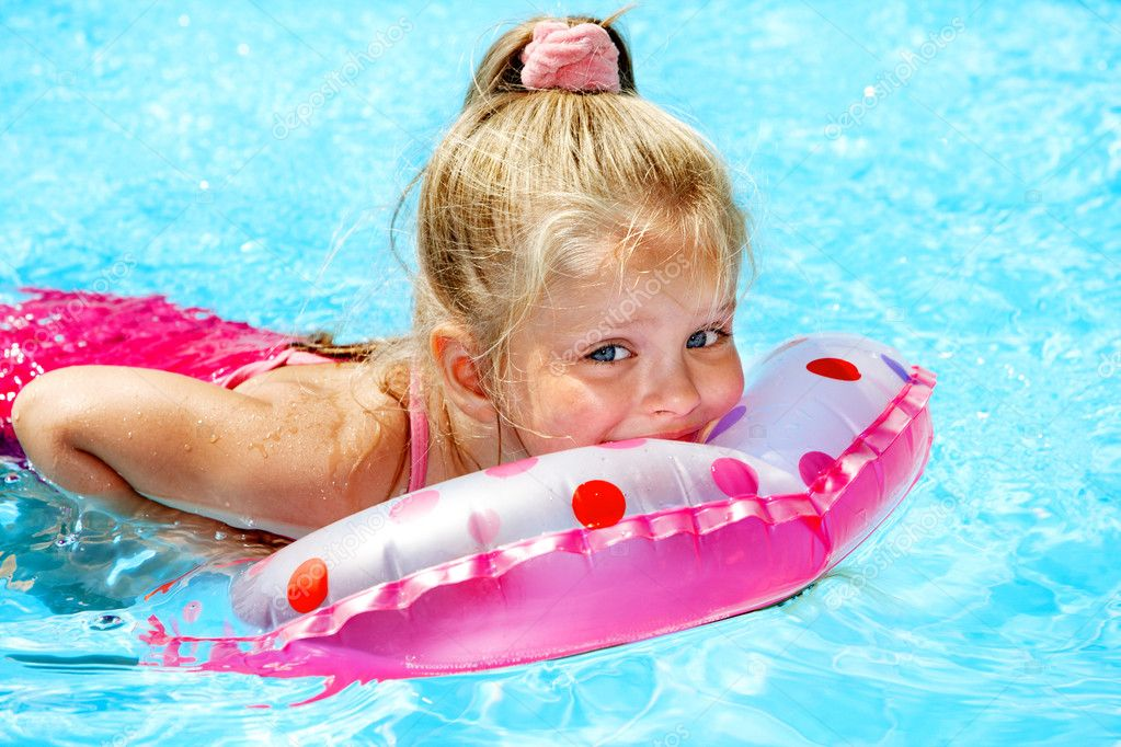 Child sitting on inflatable ring in swimming pool. — Stock Photo #9068707