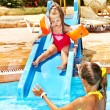 Stock Photo: Children on water slide at aquapark.