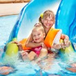 Children on water slide at aquapark. — Stock Photo #9073185
