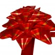 Red gift bow in front of white background - Stock Photo