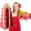 Young woman holding gift box and flowers. — Stock Photo