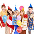 Group of young in party hat holding gift box. — Stockfoto