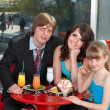 Family with child in restaurant. — Stock Photo #9078057