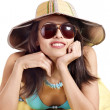 Girl in bikini and sunglasses on beach. — Stock Photo
