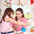 Child painting with mother at home. — Stock Photo
