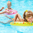 Happy family with children sitting on inflatable ring. — Stock Photo #9078920