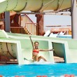 Child on water slide at aquapark. — Photo