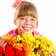 Happy child holding flowers. — Стоковое фото