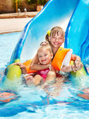 Children on water slide at aquapark. — Stockfoto