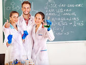 Group chemistry student with flask. — Stock Photo