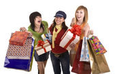 Three beautiful girlfriends enjoy shopping. Isolated. — Stock Photo
