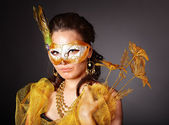 Young woman in carnival costume with mask . — Stock Photo