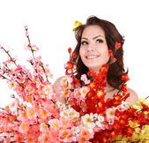 Woman with spring flower and butterfly. — Stock Photo