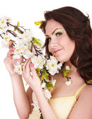 Beautiful girl with spring flower and butterfly. — Stock Photo