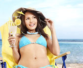 Girl in bikini drinking cocktail. — Stock Photo