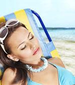 Girl in bikini relax on beach. — Stock Photo
