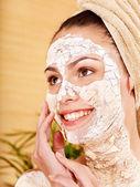 Young woman having clay facial mask. — Stock Photo