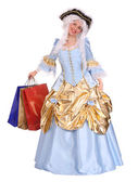 Woman in ancient dress with gift bag. — Stock Photo