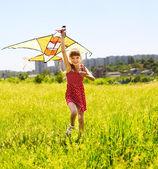 Child flying kite outdoor. — Stock Photo