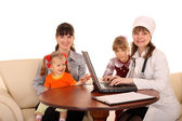 Doctor with stethoscope and family. — Stock Photo