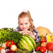 Child with vegetable on kitchen. — Stock Photo #9280108