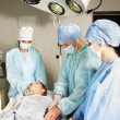 Woman on gurney in operating room. - Foto de Stock