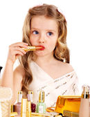 Child cosmetics. Little girl with lipstick. — Stock Photo