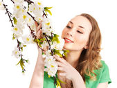 Beautiful girl with spring flower. — Stock Photo