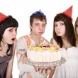 Group of teenagers with cake celebrate happy birthday. — Stock Photo