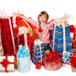 Child with group gift box thumb up. — Stock Photo