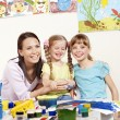 Child painting in preschool. — Stock Photo #9304055