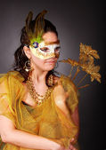 Woman in carnival costume with mask. — Stock Photo