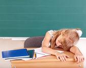 Schoolchild in classroom near blackboard. — Stock Photo