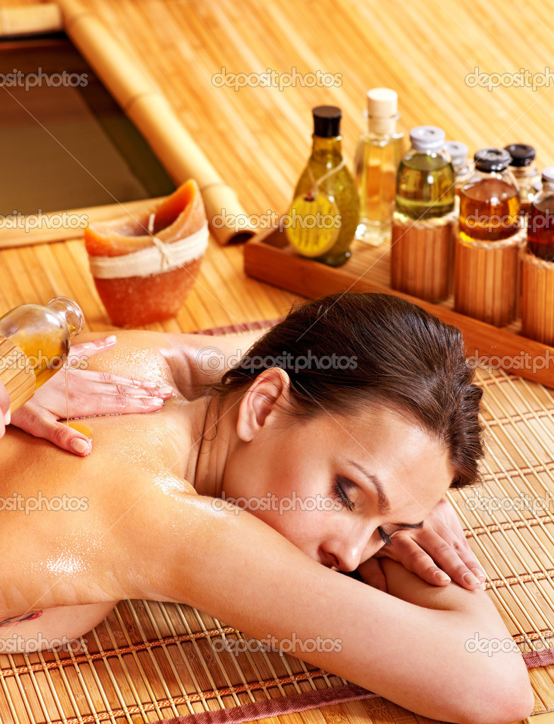 Young woman getting massage in bamboo spa. — Stock Photo #9301459