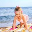 Child playing on  beach. - Stock Photo