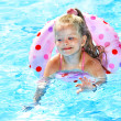 Child sitting on inflatable ring in swimming pool. — Stock Photo #9497757
