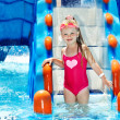 Child on water slide at aquapark. — Stock Photo #9497759