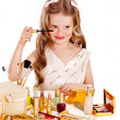 Child cosmetics. Little girl applying make up. — Stock Photo