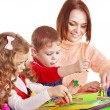 Stock Photo: Kindergarden teacher with children.
