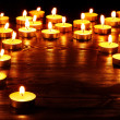 Group of  candles on  black background. - Stock Photo