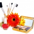 Decorative cosmetics and flower. - Stock Photo