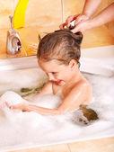 Kid washing hair by shampoo . — Stock Photo