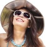 Girl in bikini and sunglasses on beach. — Stock Photo