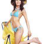Girl in bikini on beach chair. — Stock Photo