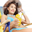 Girl in bikini drinking orange juice. — Stock Photo #9504506